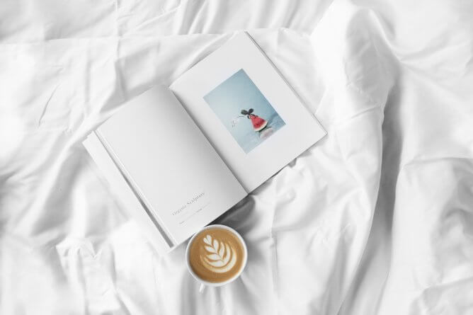 book with coffee on the bed