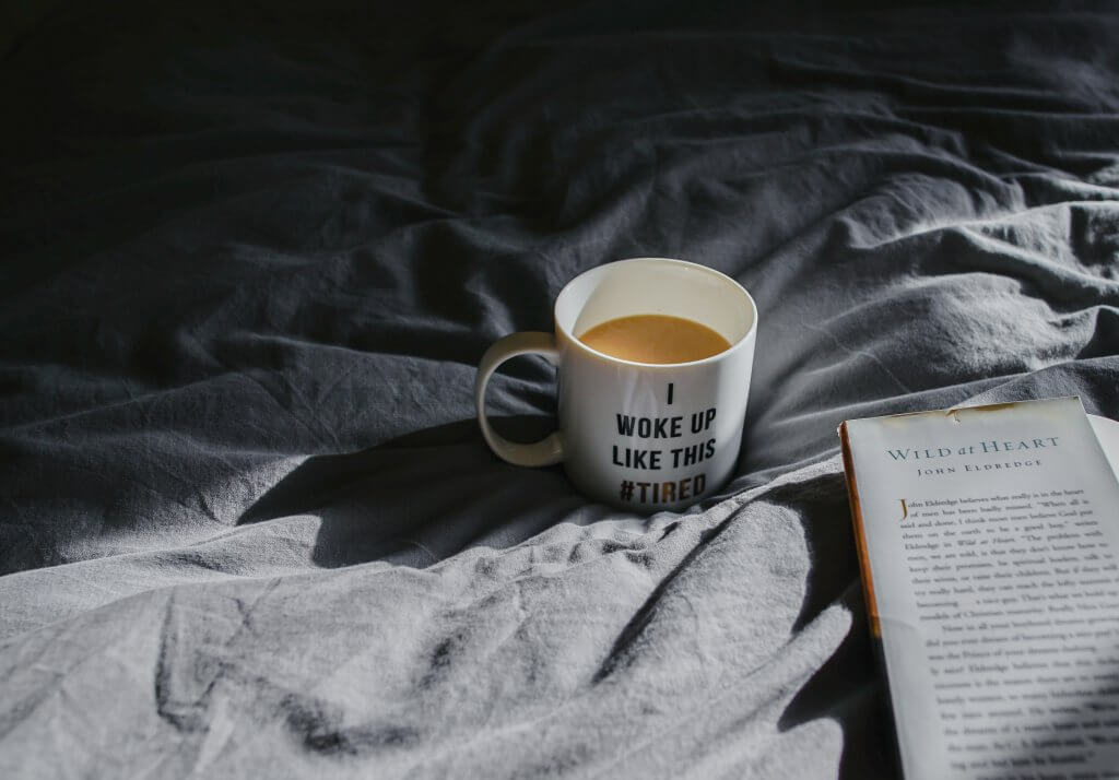 tea on the bed with book