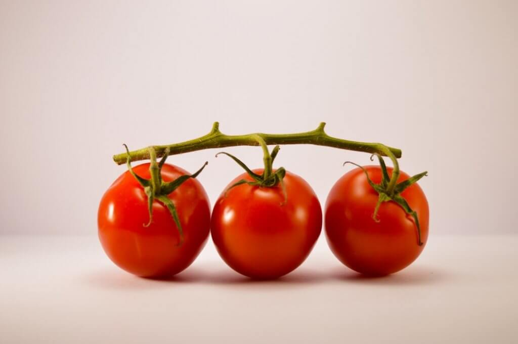 three cherry tomatoes on a table