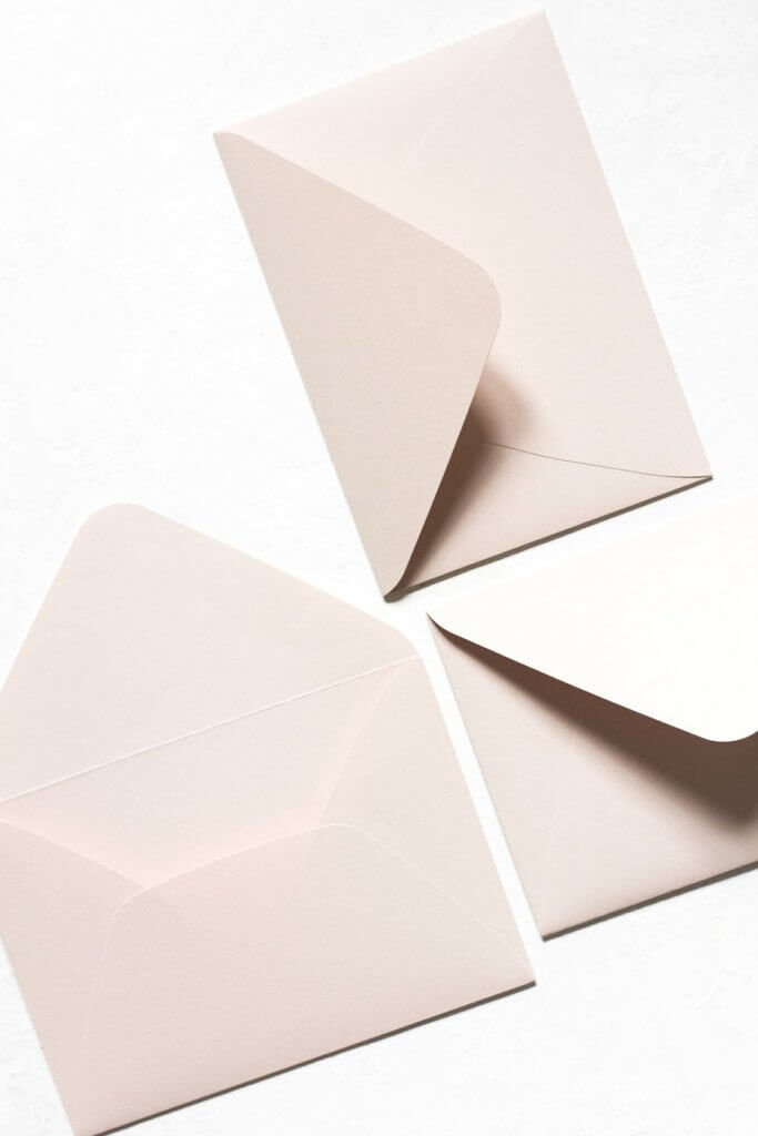 three white paper envelopes
