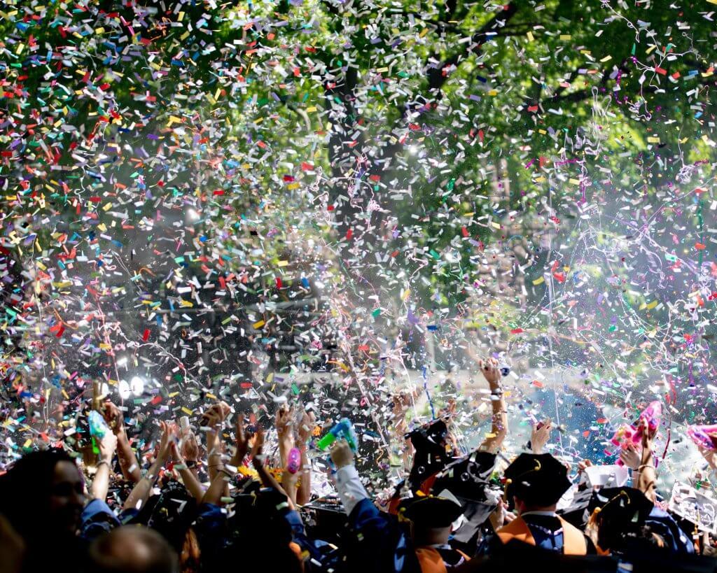 congratulating graduating students